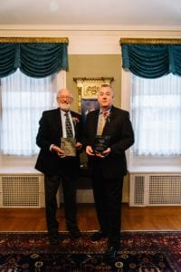 David Blocher, Volunteer, and Ken Albert, President and CEO, proudly display their Alliance awards.